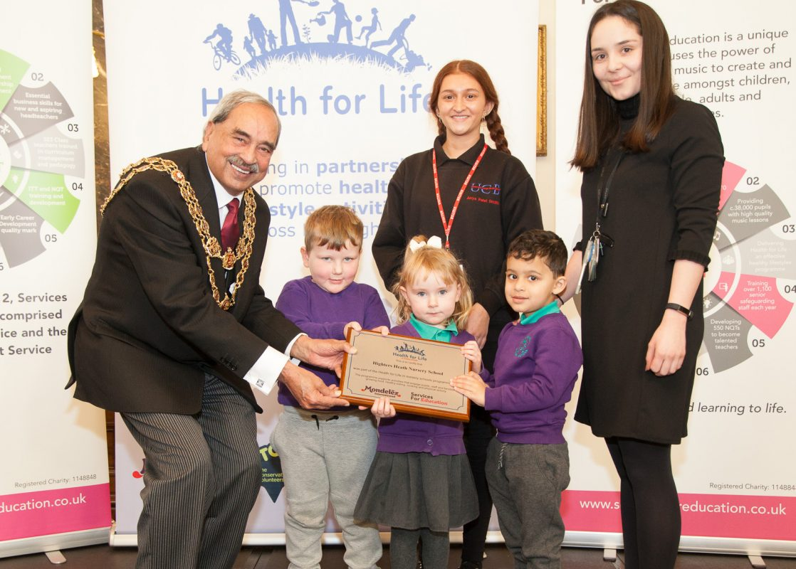 Picture of the Lord Mayor with some children at a Health for Life event